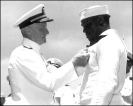 Admiral Chester Nimitz presenting the Navy Cross to Dorris Miller - Great Black Heroes